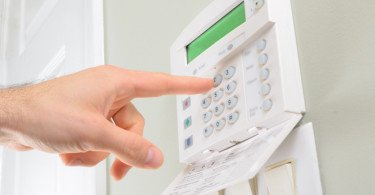 pressing the code on a house alarm