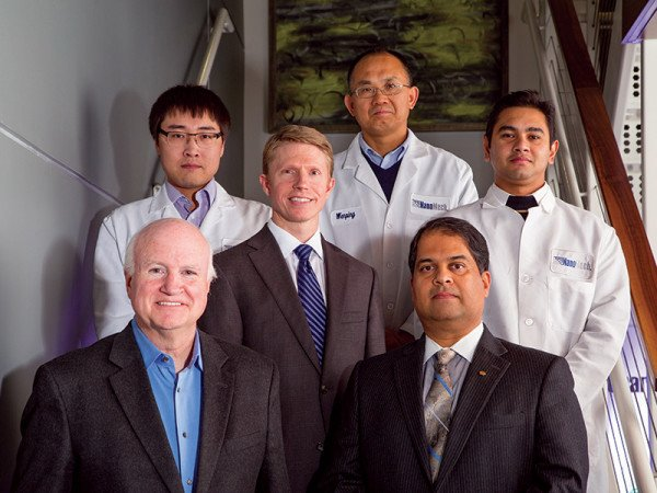 NanoMech CEO Jim Phillips and CTO Ajay Malshe (front row) with their team of scientists and innovators.