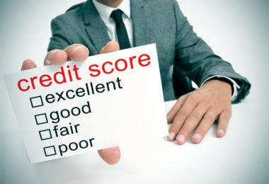 man in suit showing a signboard with the different ranges of the credit score: excellent, good, fair and poor