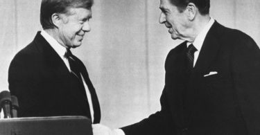 President Jimmy Carter (left) and Republican presidential candidate Ronald Reagan shake hands prior to debating before a nationwide television audience in Cleveland, OH on Oct. 28, 1980. (AP Photo)
