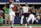 Razorback wide receiver Keon Hatcher  beats the Aggies' Nick Harvey with this touchdown catch during the first half of  what turned out to be Arkansas' fifth straight loss to A&M, this time in  Arlington, Texas. (AP photo by Tony Gutierrez)