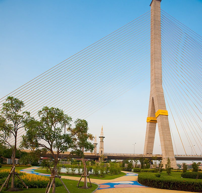 A colorful park at the foot of the Rama II cable-stayed suspension bridge in Bangkok, Thailand