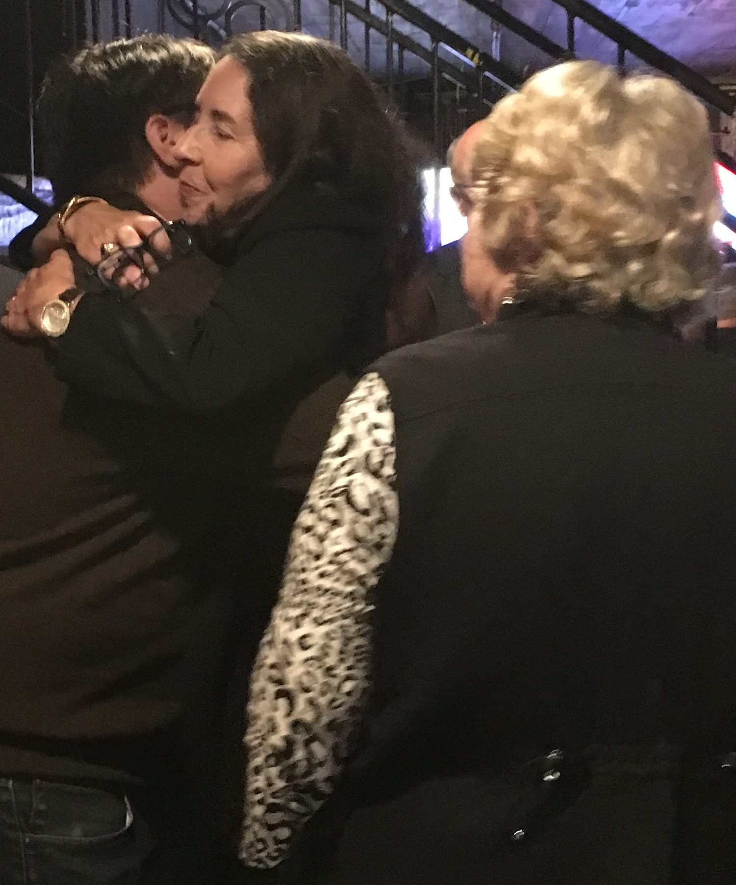 Capi Peck hugs a supporter at Cajun's Wharf. (AMP photo by Shelby Styron)