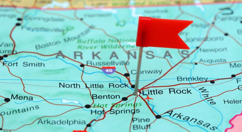 Photo of pinned Little Rock on a map of USA. May be used as illustration for travelling theme.