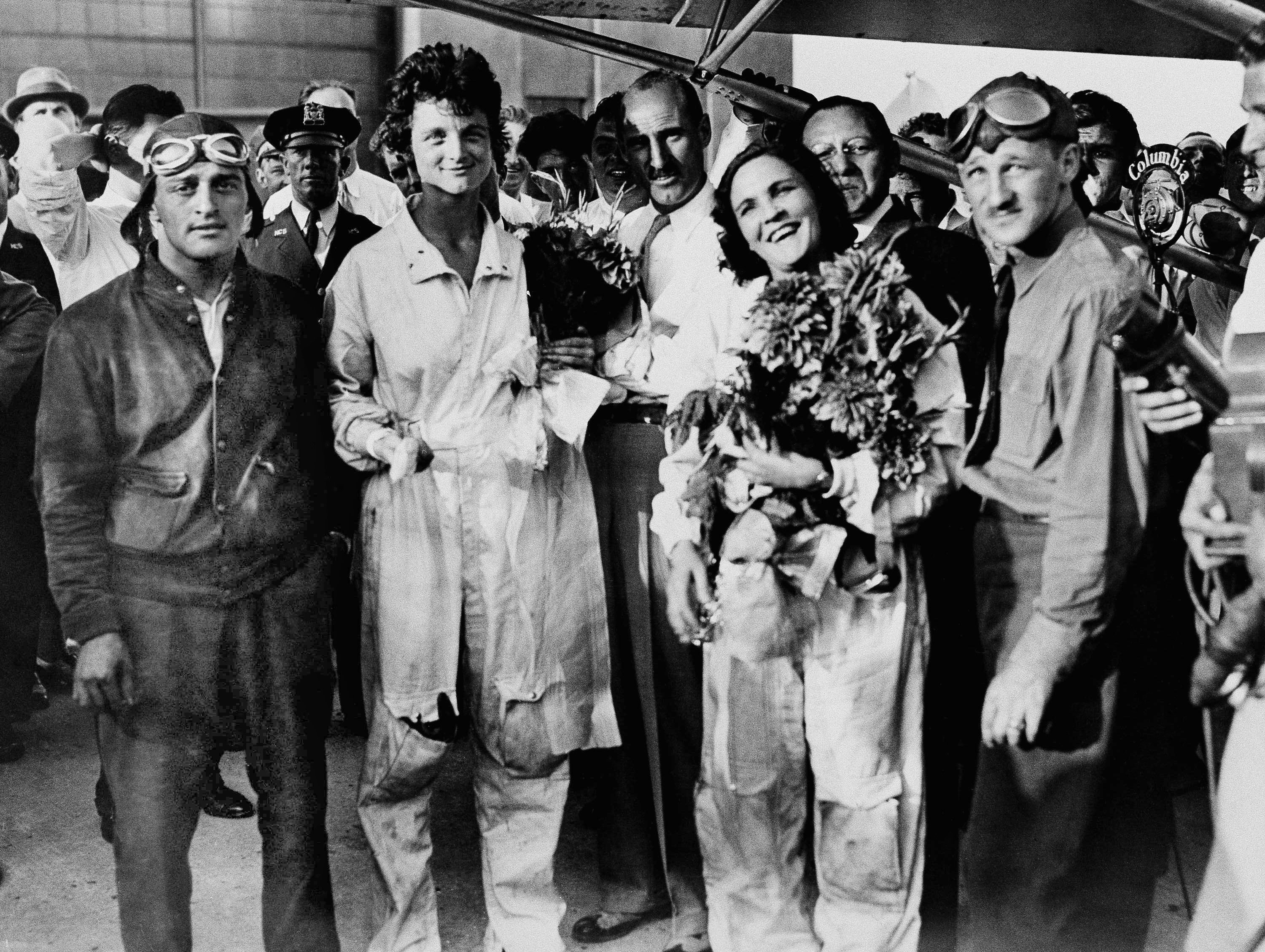 Louise Thaden (left) and Frances Marsalis after alighting from their plane at Roosevelt Field, Long Island, New York, on August 22, 1932, when they set a new women's endurance flight record with 196 hours, 6 minutes in the air. The previous record was 123 hours set in 1931 by Bobby Trout and Edna May Cooper. Others in the photo, from left: John Runger, who flew in the refueling plane; Charles S. (Casey) Jones, noted flier; and Stewart Reiss, pilot of the refueling plane. (AP file photo)