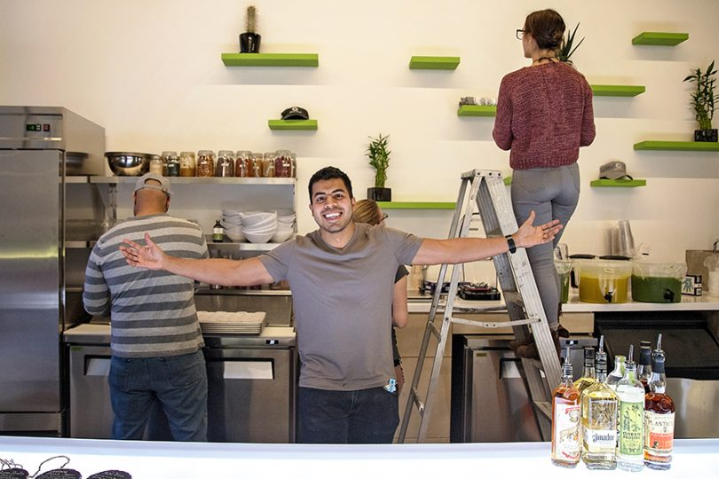 Arkansas entrepreneur Omar Kasim stands inside Juice Palm in Fayetteville