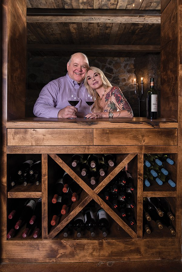 Couple standing in wine cellar