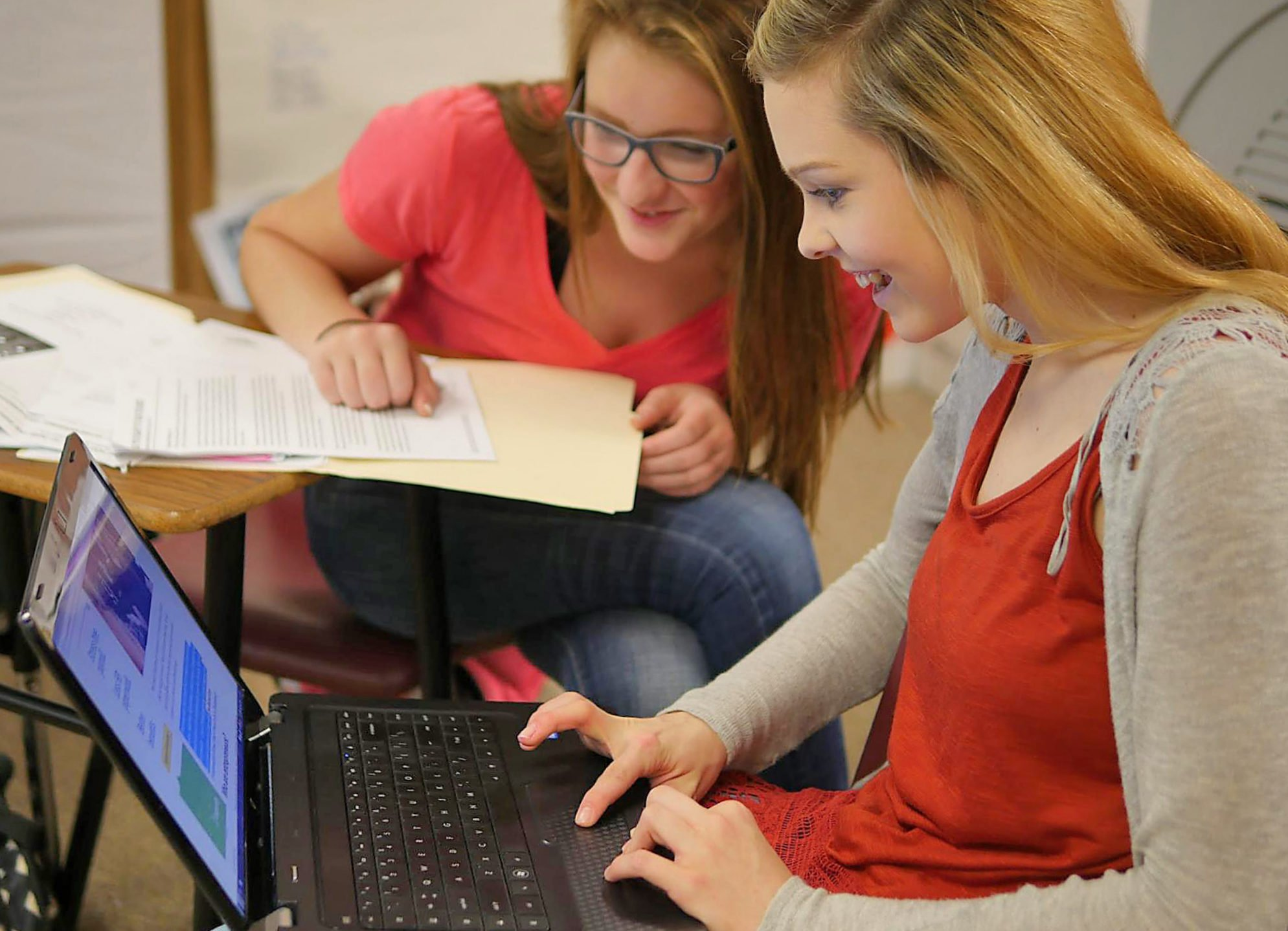 Sophomores Josephine Meinardus and Braylyne White, both third-year DECA members, collaborate on an Entrepreneurship Promotion Plan.