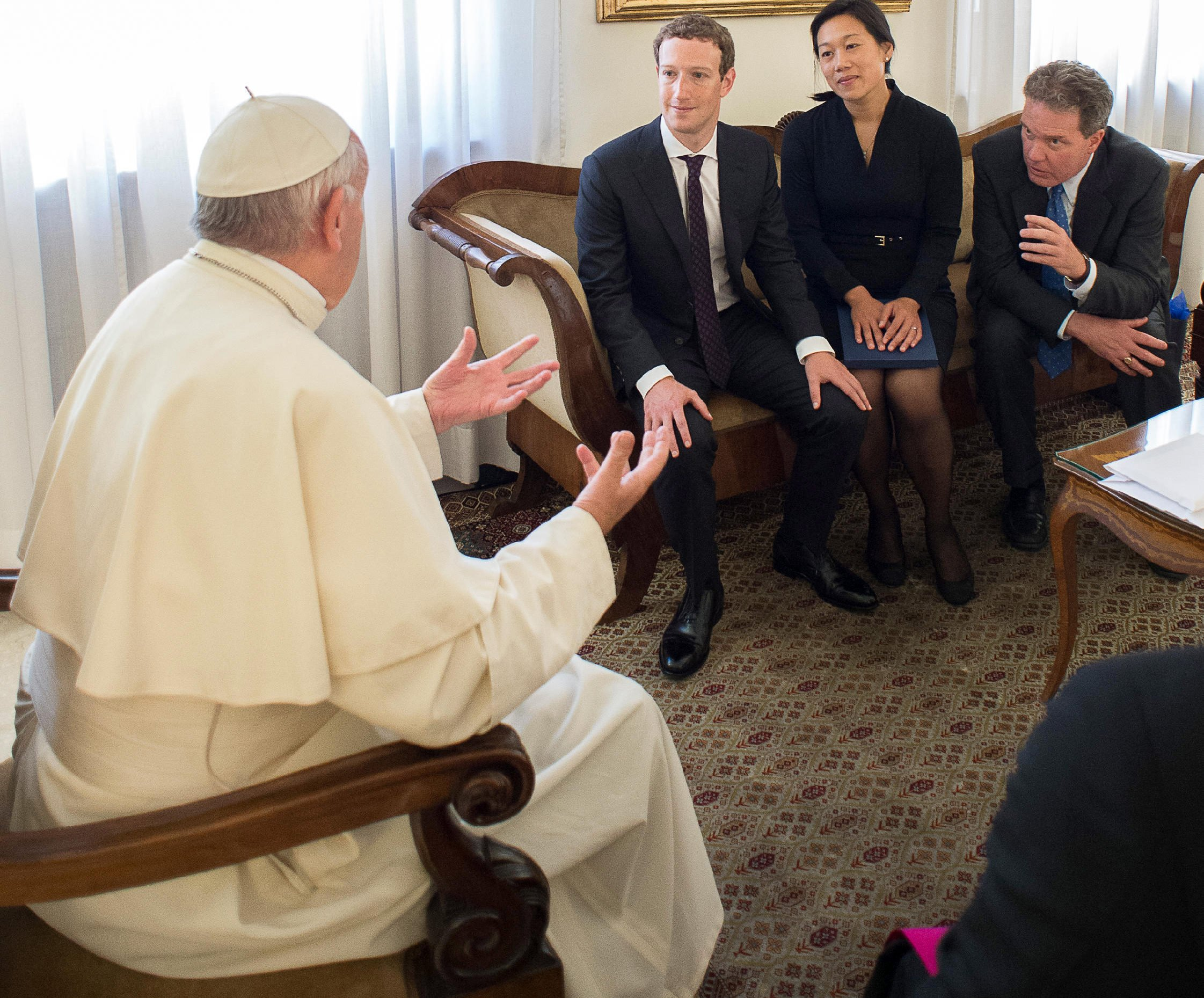 "Pope Francis meets Facebook founder and CEO Mark Zuckerberg, second from left, and his wife Priscilla Chan, at the Santa Marta residence, the guest house in Vatican City where the pope lives, Monday, Aug. 29, 2016. Vatican spokesman Greg Burke says a topic of discussion at Monday's meeting was ""how to use communication technologies to alleviate poverty, encourage a culture of encounter, and make a message of hope arrive, especially to those most in need.'' (L'Osservatore Romano/Pool Photo via AP)"