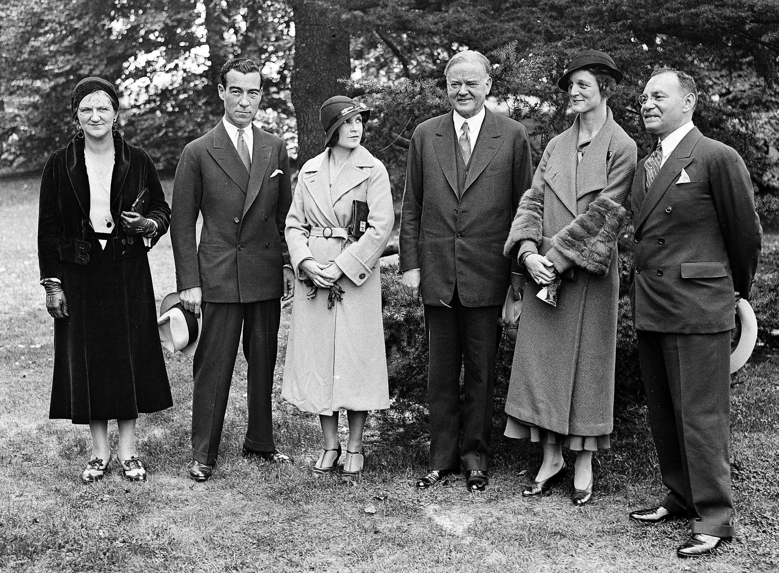 Louise Thaden stands to the left of President Herbert Hoover at the White House on September 22, 1932. Frances Marsalis, to the president's right, was her partner in setting the women's endurance flying record. Other in the photograph, from the left, are Irene Juno, fficial hostess; Clarence M. Young, assistant secretary of commerce in charge of aeronautics; and I.J. Fox, sponsor of the flight. (AP file photo)