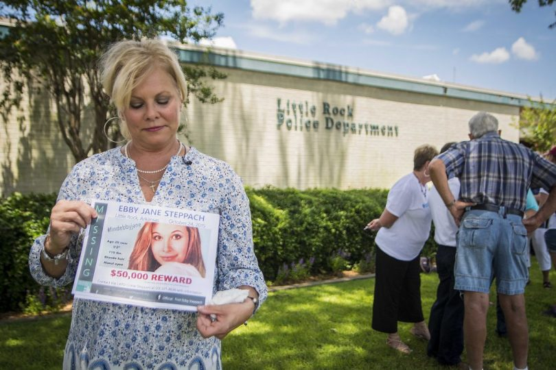 Ebby Jane Steppach's mother Laurie Jernigan holds a flier about Ebby's disappearance