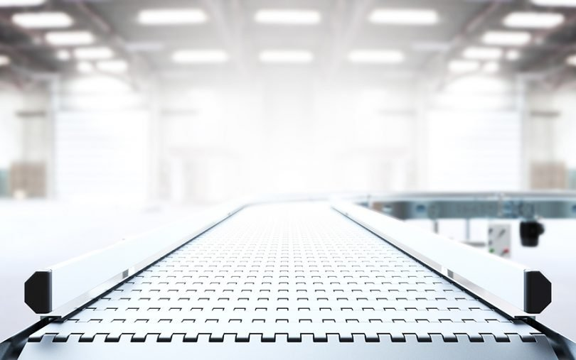 Empty conveyor belt 3D rendering in manufacturing