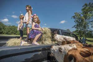 little girls in the bed of a truck